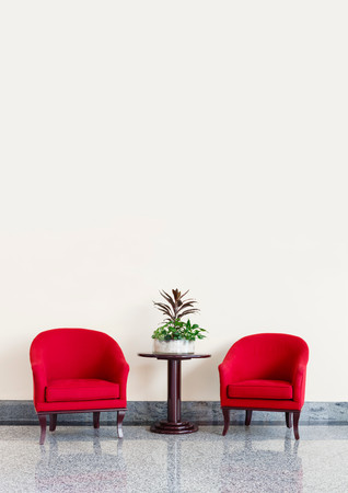 wall design: Red armchairs against a neutral wall background with copyspace