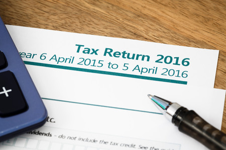 Close up of UK Income tax return form with tax period for 2016