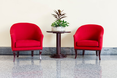 marbles close up: Modern red armchairs and table in a foyer Stock Photo
