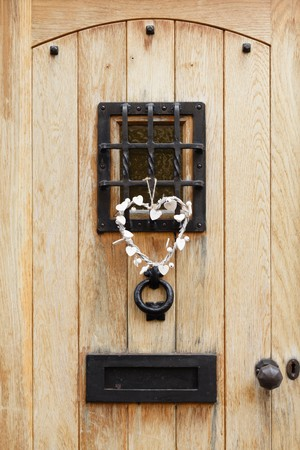panelled: Traditional wooden front door of a house with ironmongery