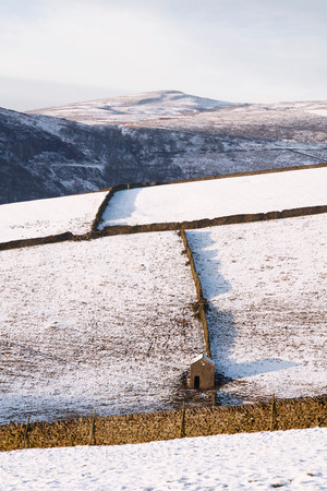 snowscene: Dry stone walls in British countryside in winter, Derbyshire, UK