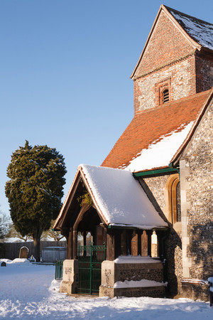 old english: Old English church covered in snow in winter