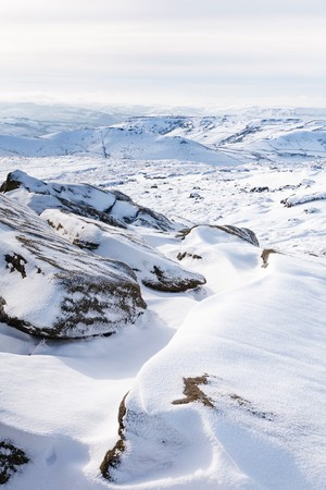 snowscene: Snow covered tor landscape in winter, Kinder Scout, Derbyshire, England, UK Stock Photo