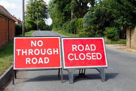roadblock: Road signs showing a street closed in the UK
