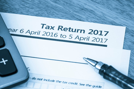 Cool toned image of UK income tax return form for 2017 Stock Photo - 72852864