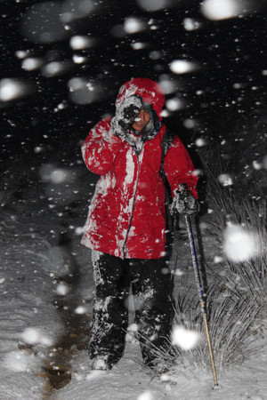 heavy snow: Female hiking in the UK in a blizzard