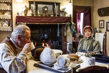 parlours: TELFORD, UK - CIRCA 2013: Actors dressed in period costume drink tea at Blists Hill Victorian Museum, Ironbridge, UK