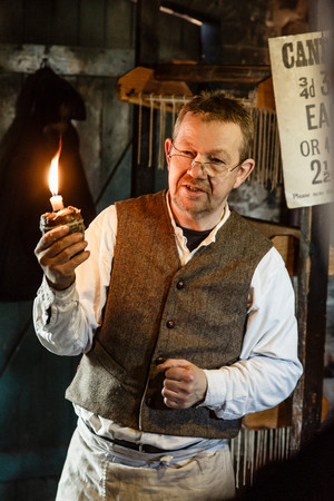 theme parks: TELFORD, UK - CIRCA 2013: Candlemaker at Blists Hill Victorian Museum, Ironbridge, UK Editorial