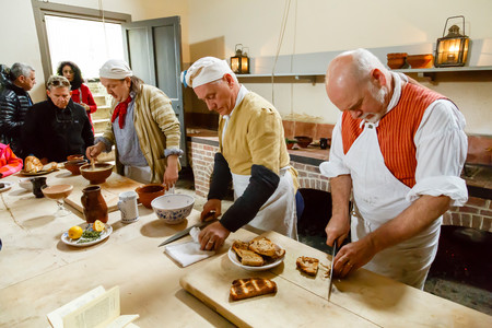 demonstrations: LONDON - CIRCA 2014: Chefs in traditional costume cooking in the Royal Kitchens, Kew Gardens, London, UK
