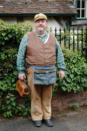 IRONBRIDGE, UK - CIRCA 2013: Tradesman in traditional costume at Blists Hill Victorian Museum. Ironbridge, Shropshire, UK