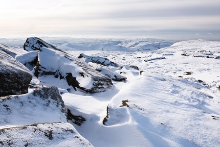 Snow covered tor landscape in winter, Kinder Scout, Derbyshire, England, UK Stock Photo