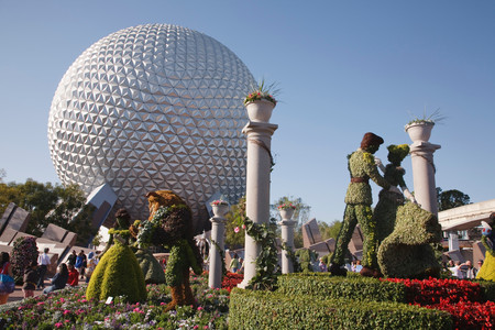 ORLANDO, USA - CIRCA 2009: Topiary Disney characters and the Spaceship Earth globe at the Epcot Center, Disneyworld, Orlando, Florida