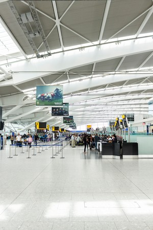 space for text: LONDON, UK - CIRCA 2017: Interior of the Departure hall in Terminal 5, Heathrow Airport