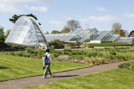 London, UK - April 18, 2014. Davies Alpine House and Princess of Wales Conservatory at Kew Botanic Gardens. The gardens were founded in 1840 and are of international significance for botanical research and education. Editorial