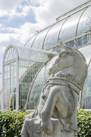 London, UK - April 18, 2014. Detail of a statue outside the Palm House at Kew Botanic Gardens. The gardens were founded in 1840 and are of international significance for botanical research and education. Editorial