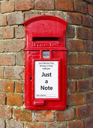 British post box with a message that reads Just a Note, ideal for a greeting card design