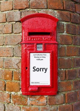 British post box with a message that reads Sorry, ideal for a greeting card design Foto de archivo