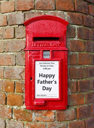 British post box with a message that reads Happy Fathers Day, ideal for a greeting card design