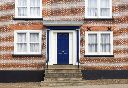 Winslow, UK - April 27, 2015. Front door of a traditional historic brick house in the UK Redakční