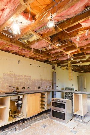 Home renovation scene with a kitchen ceiling ripout prior to a refurbishment and kitchen fitting Foto de archivo