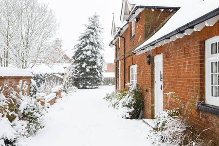 English country home in winter with a driveway covered in snow Stock Photo - 107634757