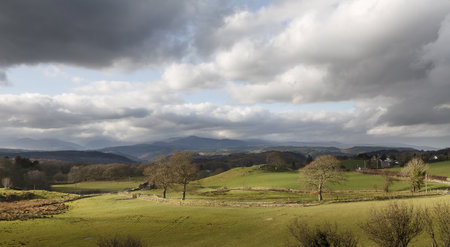 Welsh green hills with mountains in the background. Snowdonia National Park near Betys-y-coed, Conwy, Wales.