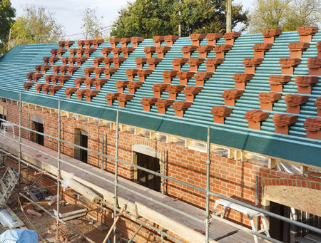 Clay tiles stacked on a roof in the UK ready for a new roof installation