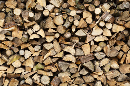 Closeup of firewood stacked ready for winter