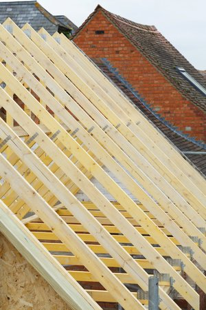 Detail of timber roof trusses on a new roof under construction Stock Photo