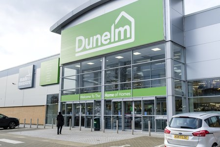 Milton Keynes, UK - February 11, 2019. Exterior of a Dunelm Store on a retail park in Milton Keynes, UK. Dunelm Group Plc is a British home furnishings retailer listed on the FTSE.