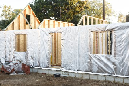 Modern house construction with timber frame and foil wall insulation