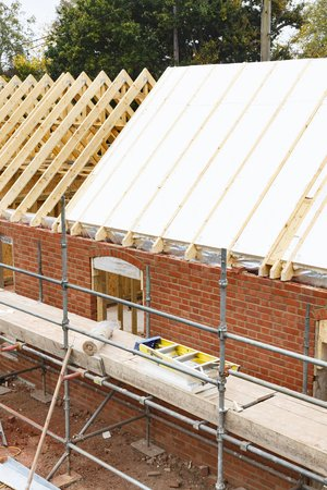 Solid sheet insulation install to a roof under construction in the UK