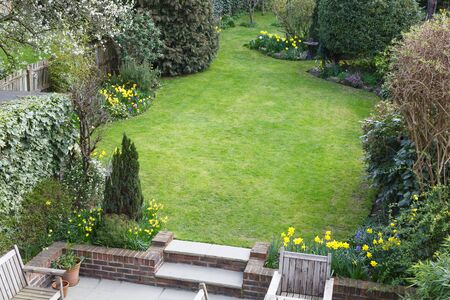 Lawn of a suburban back garden in London England, viewed from above