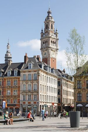 Lille, France - July 20, 2013. Place Charles de Gaulle and the clock tower above La Vieille Bourse de Lille, the former stock exchange in the historic city centre of Lille, France Stockfoto - 130078418