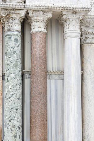 Closeup detail of marble stone columns outside St Marks Basilica, Venice, Italy Stock Photo