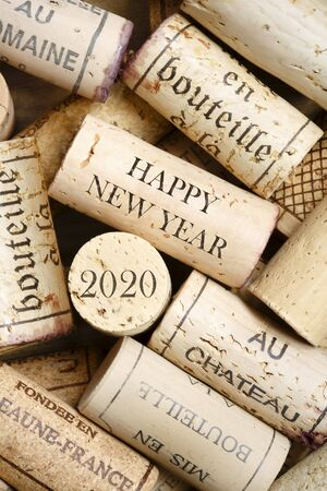 Happy New Year 2020 greeting card with wine corks. No visible trademarks
