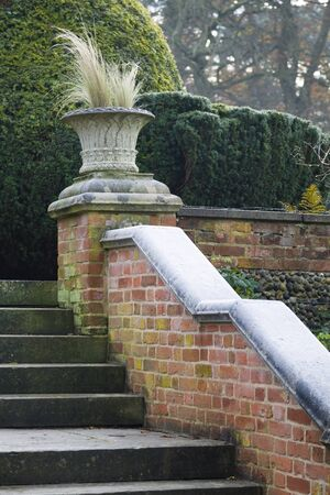 Steps in a formal landscaped English garden in England, UK