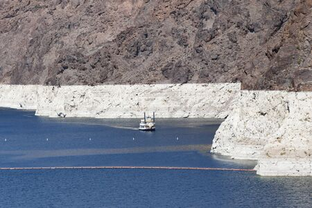 NEVADA, USA - May 21, 2012. A white band on the edge of Lake Mead in Nevada and Arizona shows the low water level in a period of drought Editorial