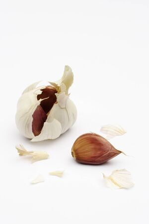 Garlic bulb and cloves on a white background