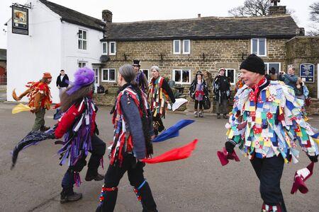 PEAK DISTRICT, UK - January 29, 2012. Morris dancers perform outside the Barrel Inn in Derbyshire, UK. Morris dancing is a folk tradition with Pagan origins. Editorial