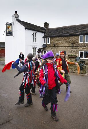 PEAK DISTRICT, UK - January 29, 2012. Morris dancers perform a traditional pagan dance outside the Barrel Inn in Derbyshire, UK. Editorial