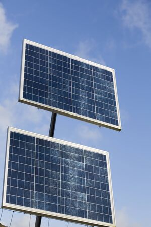 Solar panels against a blue sky, UK. These are small panels used to provide power in remote locations