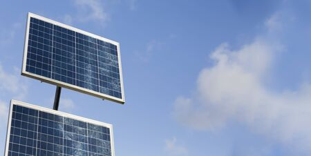 Solar panels against a blue sky with copyspace. These are small panels used to provide power in remote locations