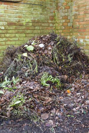 Composting, compost heap in a garden, UK