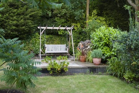 Back garden and patio with furniture in a British home, UK