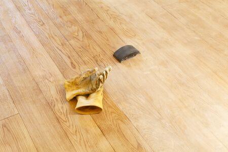 Sanding a floor with a sanding block, home improvement DIY project, UK