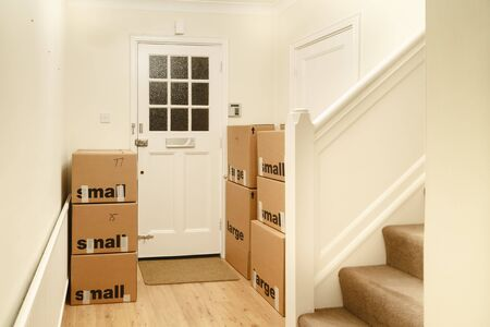 Stack of cardboard packing boxes, moving house, relocation to a new home, UK
