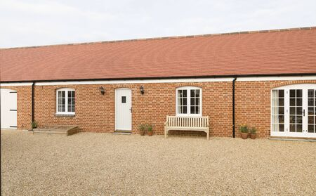 Barn conversion to provide a single storey granny annexe, annex. UK house exterior