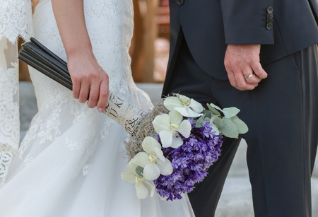 purl: Nice wedding bouquet in brides hand Stock Photo