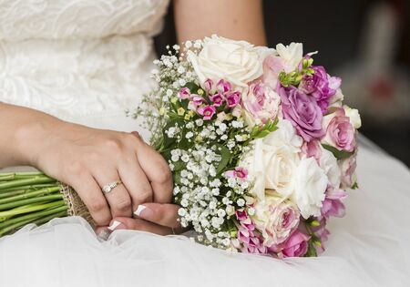 Nice wedding bouquet in brides hand Stock Photo